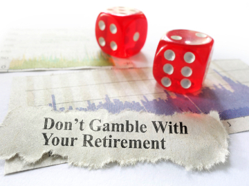 "dice with a stock chart and caption saying ""Don't Gamble With Your Retirement"""