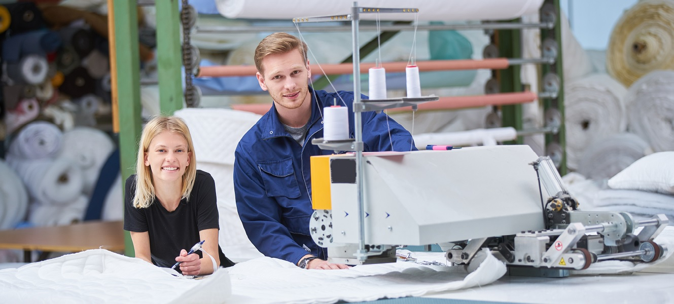 Manufacturing business couple with machinery for textiles