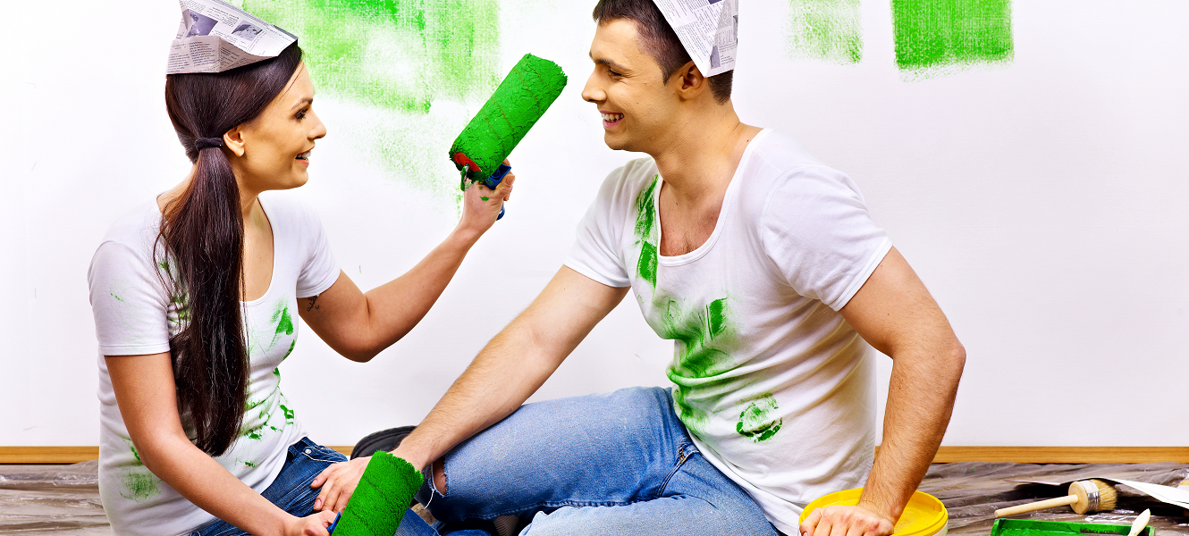 Couple painting green walls and themselves making a mess remodeling